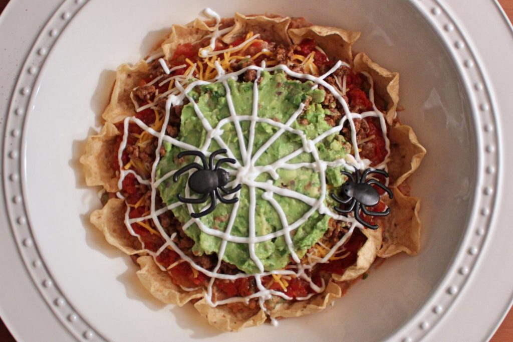 Spidery 5 Layer Nacho Dip! An easy, fun, feeds-crowds recipe for your next Halloween Party! | BearandBugEats.com