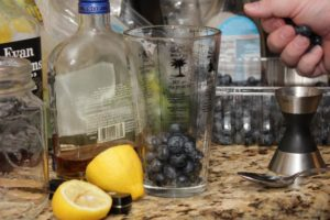 The Kentucky Cobbler cocktail! Perfect seasonal blueberries muddle with bourbon, lemon, brandy and agave for a lazy sippin' drink. | cocktail recipes | blueberry recipes | BearandBugEats.com