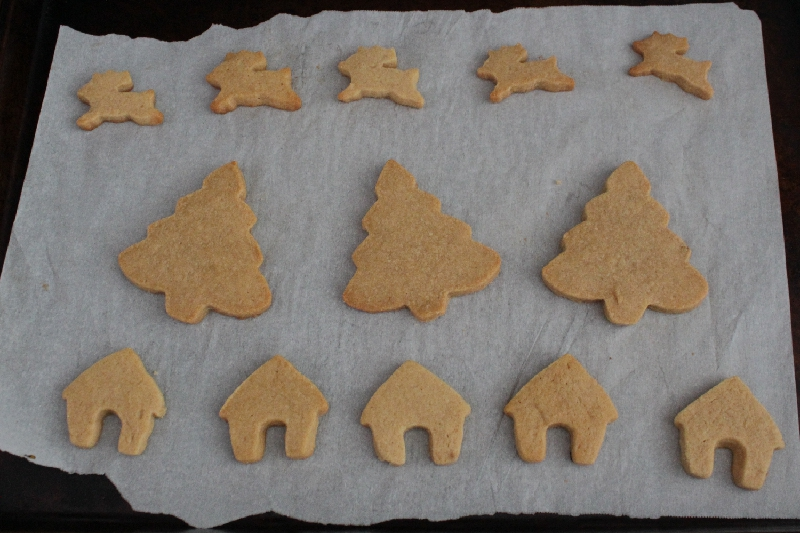 Peanut butter cookies in the shapes of reindeer, Christmas trees, and houses