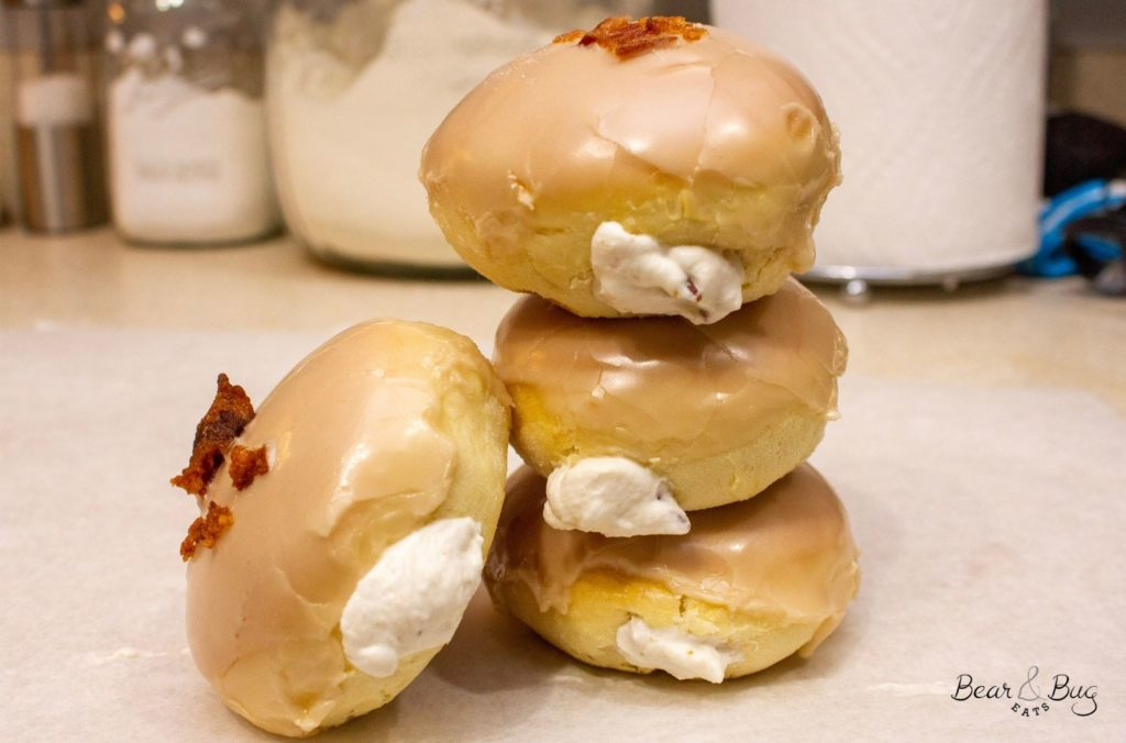 Stack of finished maple bacon cream baked donuts
