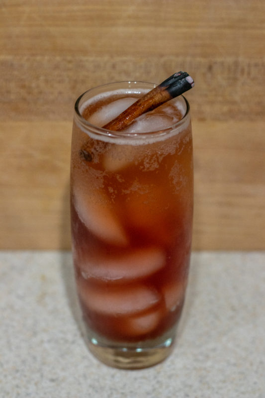 Finished Give it a Chai Mocktail with scorched cinnamon stick on top
