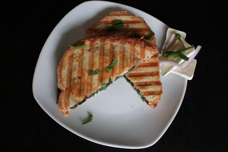 Completed bacon brie panini on plate